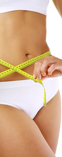Measuring Tape Around A Woman's Stomach Photo - Cosmetic Surgery Center