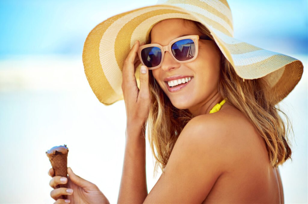 Young Woman Enjoys Ice Cream by the Pool After Summer Glow Up Checklist
